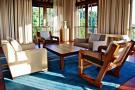 Living room wood balcony doors Four Seasons Seychelles