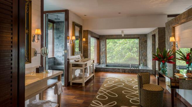 Bathroom wood floor bath tub shower twin sink Four Seasons Seychelles