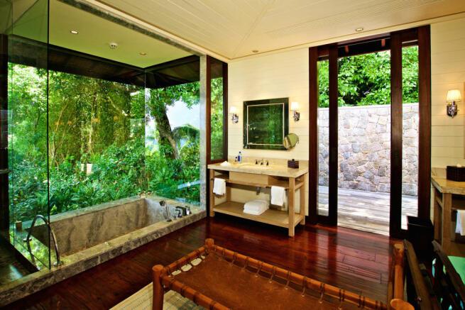 Bathroom marble bath tub sink wood floor Four Seasons Seychelles