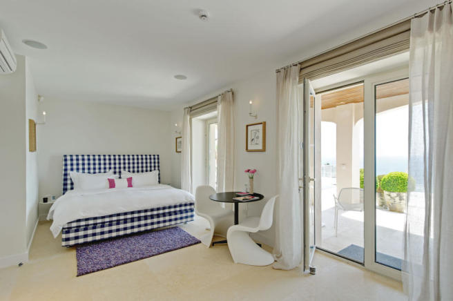 Bedroom patio doors stone floor Villa Surram Theoule-sur-Mer Cote d'Azur