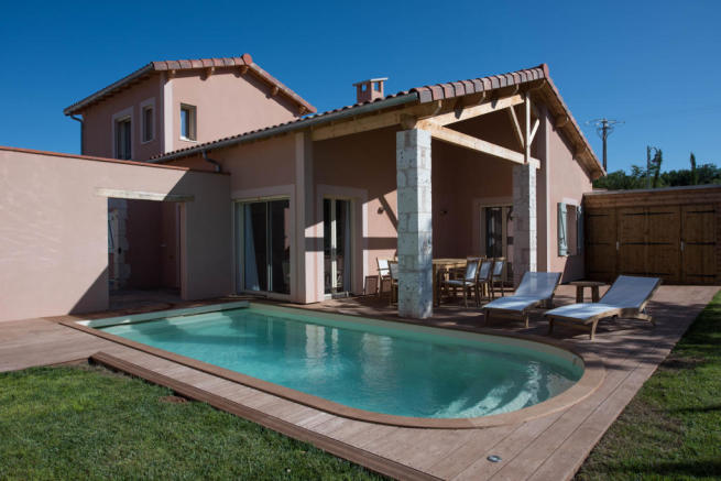 External facade of villa with pool