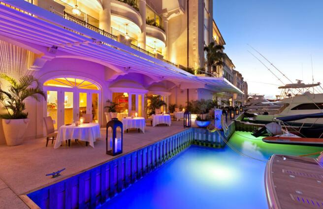 Swimming pool dusk terrace Port Ferdinand Barbados
