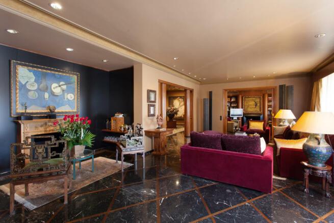 Living room marble floor fireplace The Penthouse Av de Pau Casals Barcelona