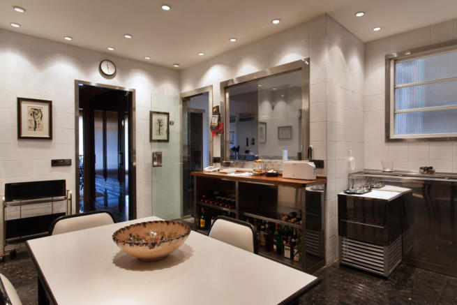Kitchen stone floor modern wine The Penthouse Av de Pau Casals Barcelona