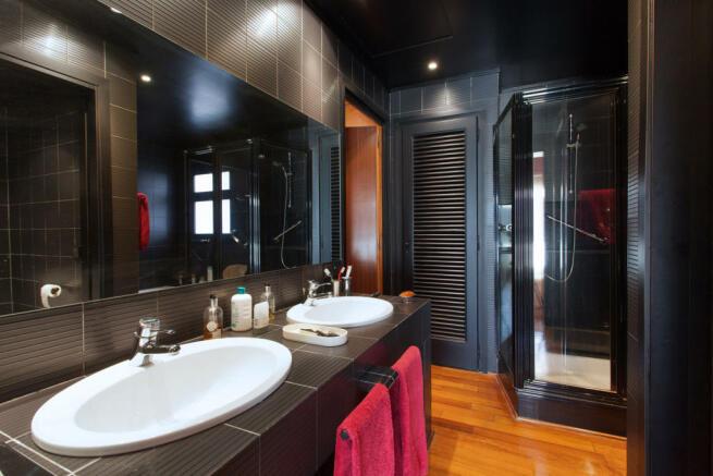 Bathroom twin sink stone shower wood floor The Penthouse Av de Pau Casals Barcelona