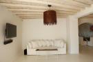 Living room white exposed beams Fanari Mykonos