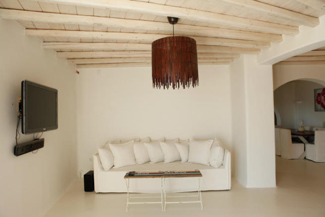 Living room white exposed beams Fanari Mykonos