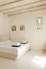 Bedroom white tiled floor Fanari Mykonos