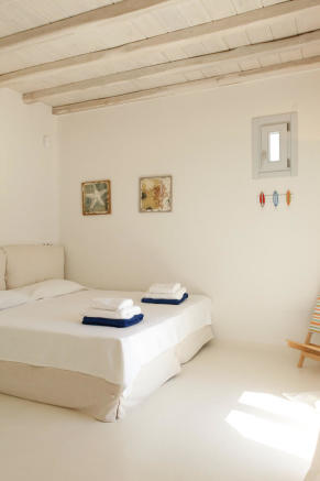 Bedroom white tiled floor Fanari Mykonos