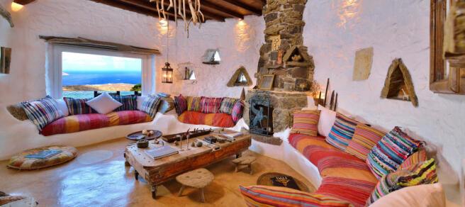 Living room stone curved Lia Mykonos