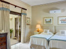 Bedroom twin ensuite bathroom marble floor Sand Box at Sandy Lane Barbados