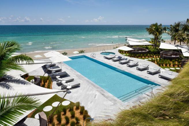 Swimming pool sun terrace beach ocean sea view Regalia Miami Florida