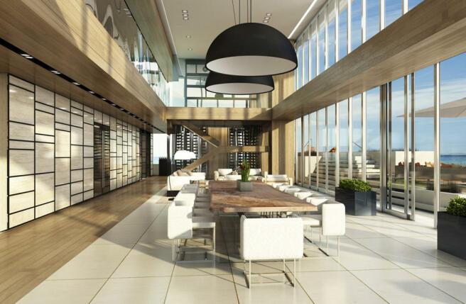 Living room dining full height ceiling sliding doors terrace Regalia Miami Florida