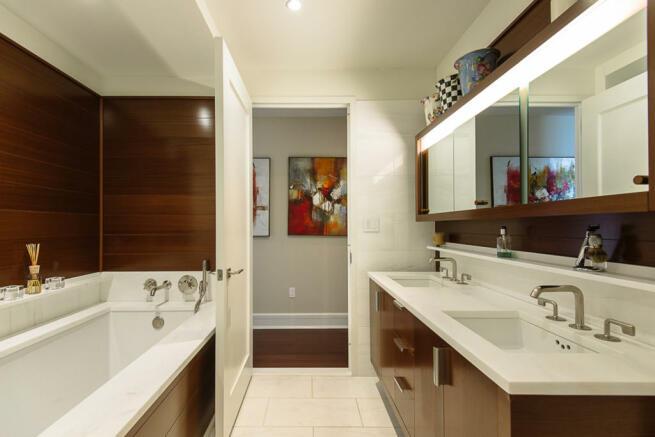 Bathroom twin sink bath tub tiled wood Riverside Boulevard New York