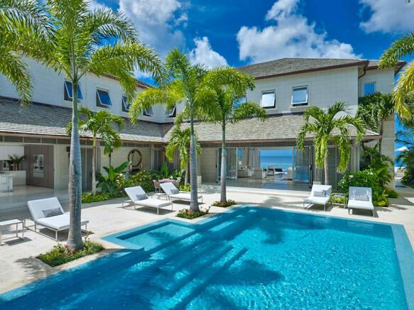 Swimming pool sun terrace palm tree Villa Bonita Barbados