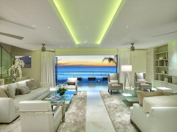 Living room sliding doors stone floor sea ocean view Villa Bonita Barbados