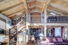 Full height ceiling mezzanine living room open plan staircase wood Chalet Feuille d'Erable Verbier