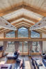Living room full height ceiling windows Chalet Feuille d'Erable Verbier