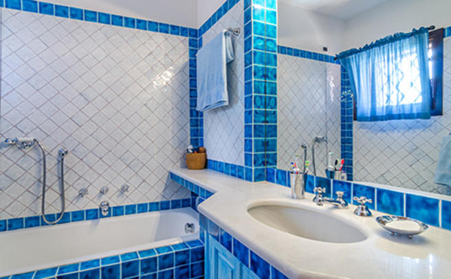 Bathroom blue white tiled bath sink tub Villa Li Liccioli Sardinia