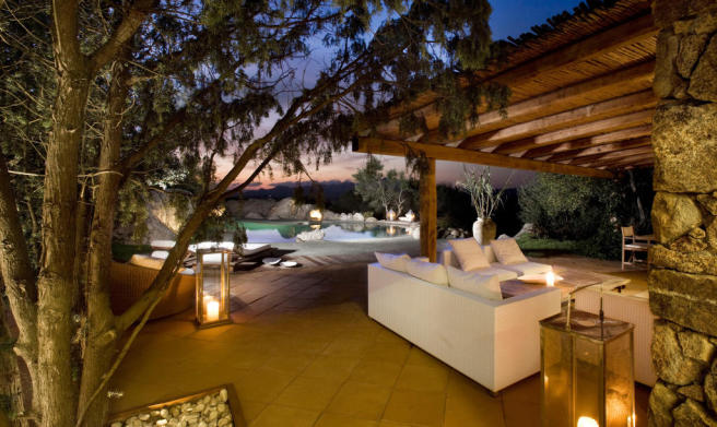 Covered area night tiled swimming pool Villa Ross Sardinia