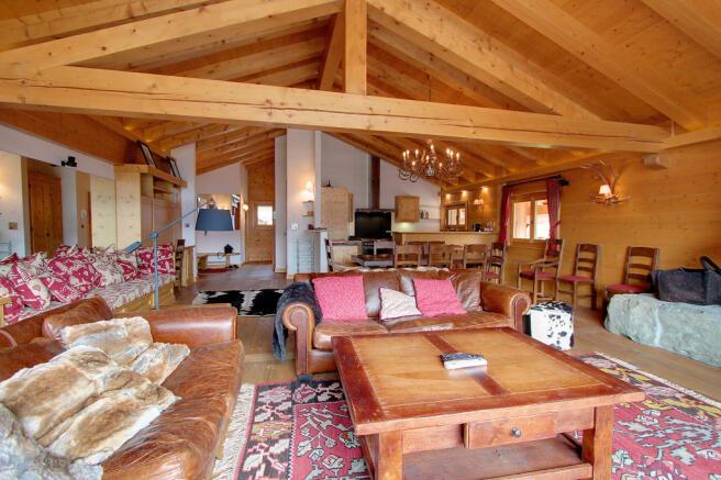 Living room fireplace open plan wood floor Gai Torrent Penthouse Verbier