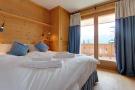 Bedroom balcony doors wood floor Gai Torrent Penthouse Verbier