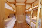 Bedroom bunk beds wood floor Gai Torrent Penthouse Verbier