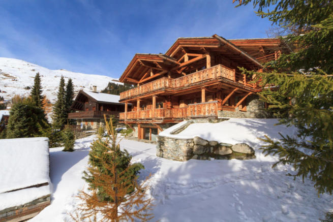 Chalet façade in the snow from side angle