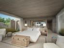 Bedroom master stone large windows Zil Pasyon Residences Seychelles