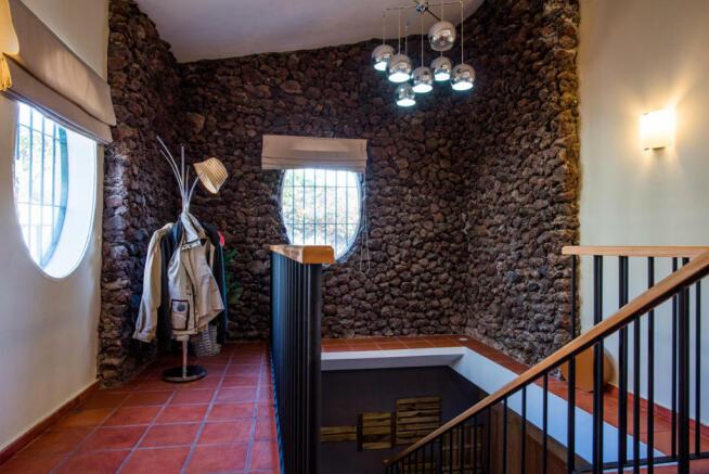 Stairs hallway stone tiled floor circular window Villa Aquarela Madeira Portugal