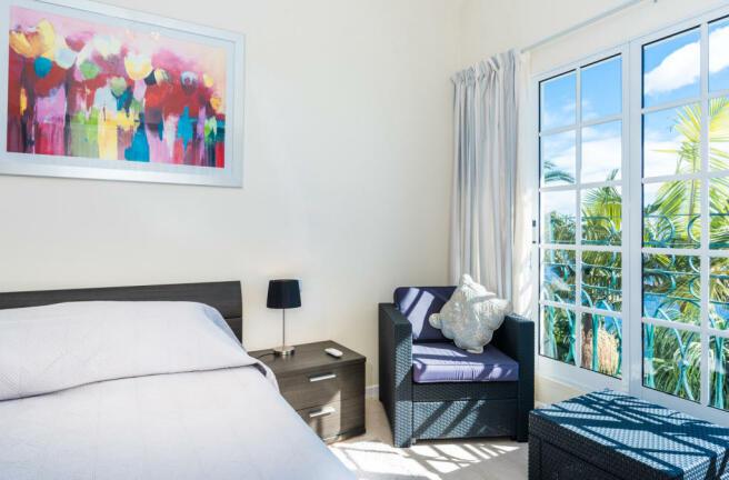 Bedroom large windows stone floor Villa Aquarela Madeira Portugal