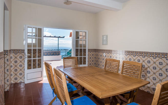 Dining room patio doors balcony tiled floor Villa Aquarela Madeira Portugal