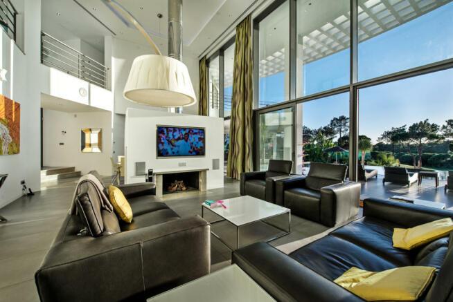 Living room open plan stone floor sliding doors full height ceiling Villa Sara Quinta do Lago Algarve