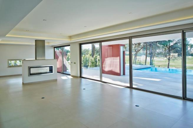 Living room large sliding doors stone floor fireplace Villa Moderno Algarve