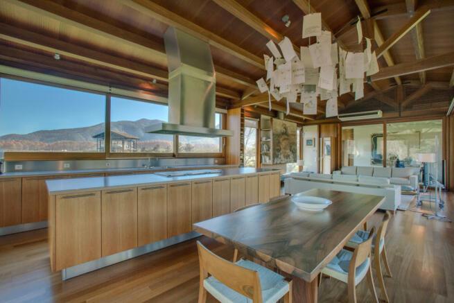 LIving room dining kitchen open plan wood floor Finca Mia Vall d'en Bas Girona