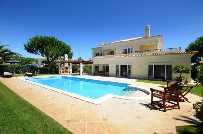 Rear facade swimming pool garden Villa Marisa Quinta do Lago Portugal