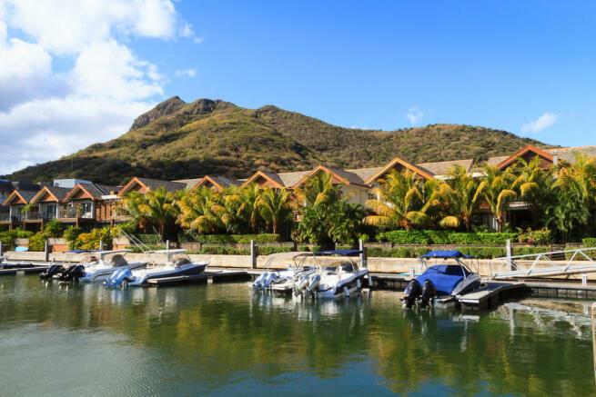 Berths outside homes at La Balise Marina in Mauritius
