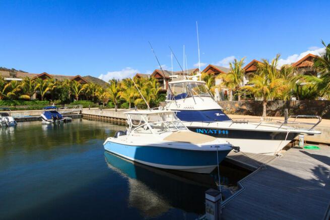 Boat berths outside duplex homes at La Balise Marina in Mauritius