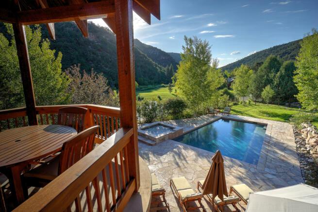 Swimming poo hot tub terrace sun outdoor dining area Cascabel Ranch Colorado