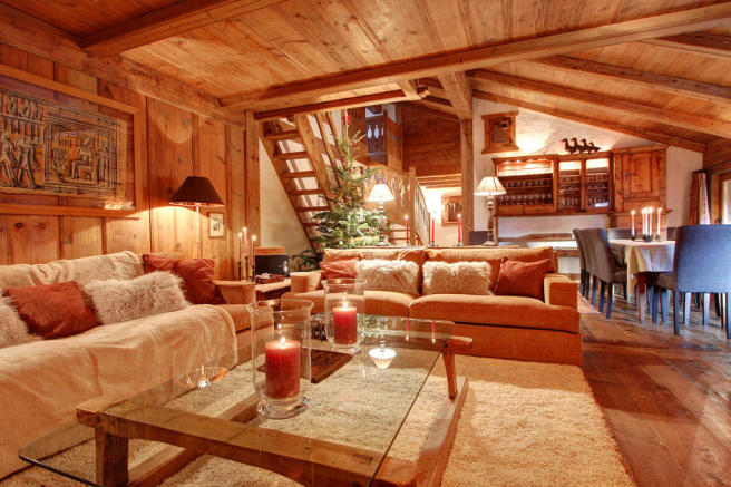 Living room dining wood floor open plan exposed beams Le Clarmont Penthouse Verbier