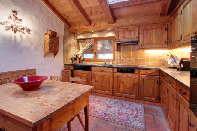 Kitchen tiled floor wood dining table Le Clarmont Penthouse Verbier