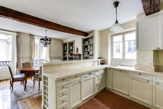 Kitchen diner wood floor beams marble Rue de Turenne Paris