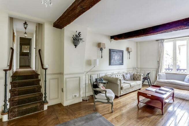 Living room wood floors beams stairs Rue de Turenne Paris