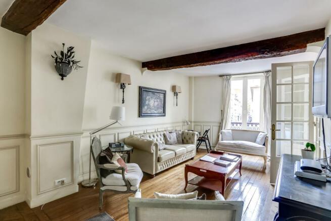 Living room wood floors beams Rue de Turenne Paris
