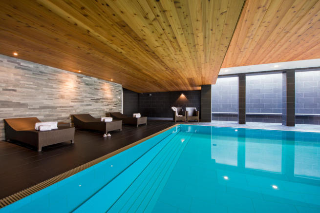 Spa and pool area with seating at Valentine 210