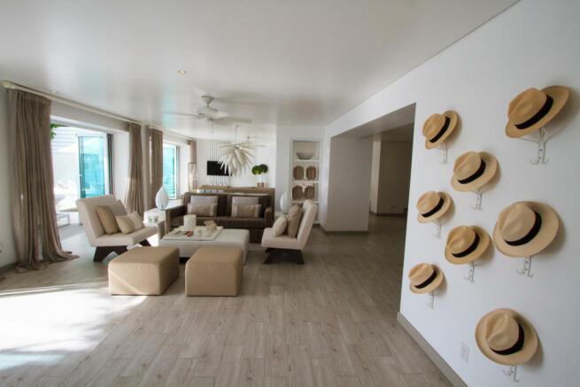 Living room large wood floor sliding doors Footprints Barbados