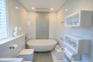 Bathroom bath tub white tiled Footprints Barbados