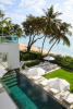 Rear view sun terrace ocean sea palm tree swimming pool Footprints Barbados
