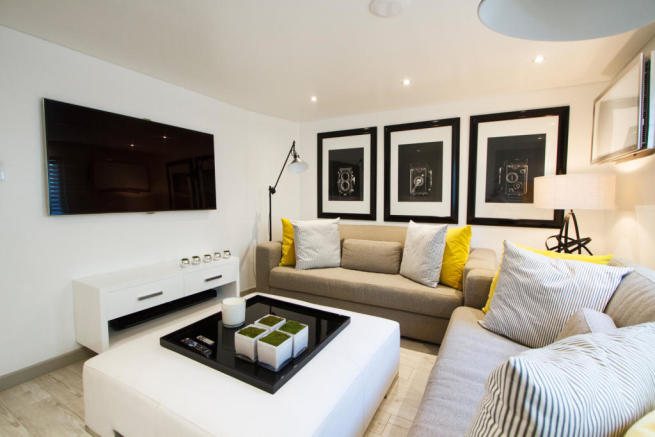 Living room tv modern cinema room Footprints Barbados