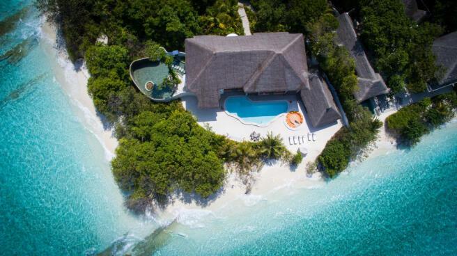 Aerial swimming pool facade ocean Villa Sunrise at Soneva Fushi Maldives